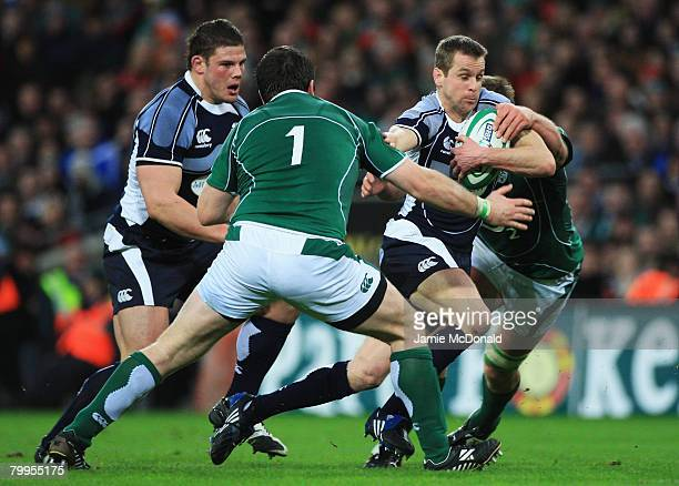 Chris Paterson of Scotland is tackled by Marcus Horan of Ireland during the RBS 6 Nations Championship match between Ireland and Scotland at Croke...