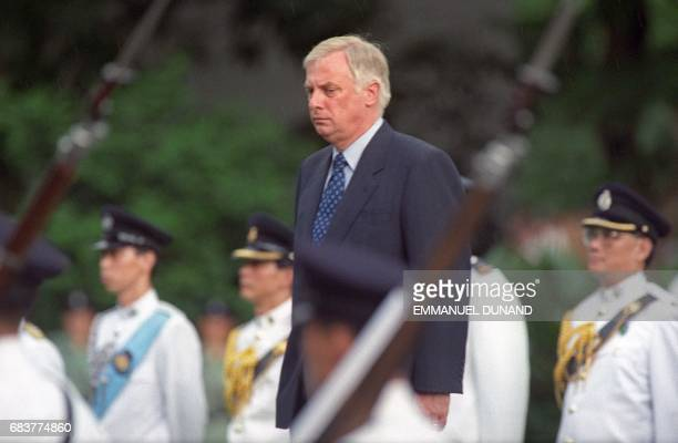 Chris Patten the 28th and last governor of colonial Hong Kong stands for a farewell ceremony at Government House the governor's official residence in...