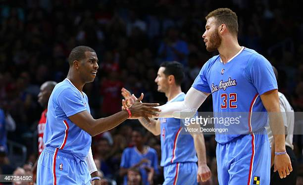 Chris Paul and Blake Griffin of the Los Angeles Clippers celebrate after a scoring play in the second half against the New Orleans Pelicans during...