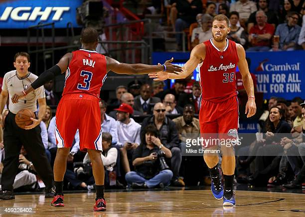 Chris Paul and Blake Griffin of the Los Angeles Clippers high five after a play during a game against the Miami Heat at American Airlines Arena on...