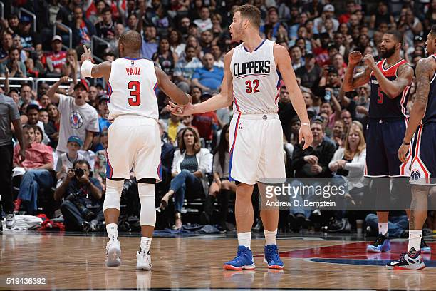 Chris Paul and Blake Griffin of the Los Angeles Clippers high five during the game against the Washington Wizards at STAPLES Center on April 03 2016...
