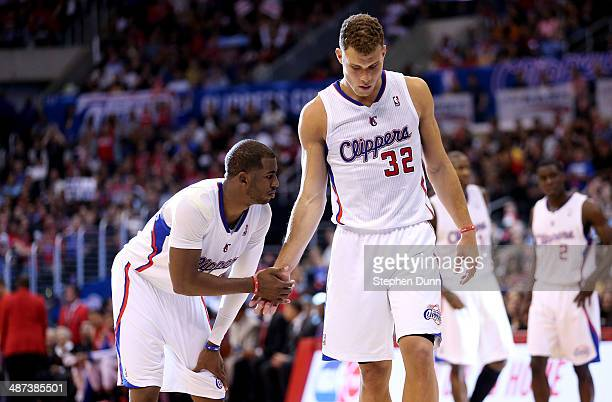 Chris Paul and Blake Griffin of the Los Angeles Clippers shake hands as they come out of a time out against the Golden State Warriors in Game Five of...