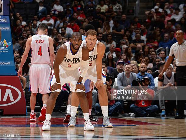 Chris Paul and Blake Griffin of the Los Angeles Clippers stand on the court during the game against the Denver Nuggets at STAPLES Center on October...