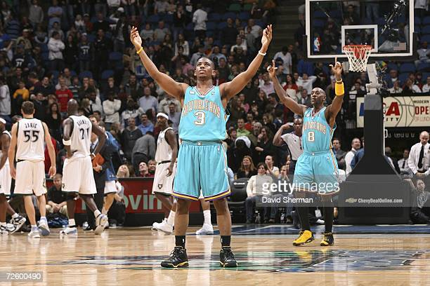 Chris Paul and Bobby Jackson of the New Orleans/Oklahoma City Hornets celebrate the moment after the winning basket sinks in the game against the...