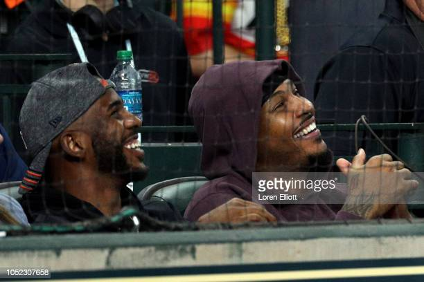 Chris Paul and Carmelo Anthony jokes with Red Sox players in between innings during Game 3 of the ALCS between the Boston Red Sox and the Houston...