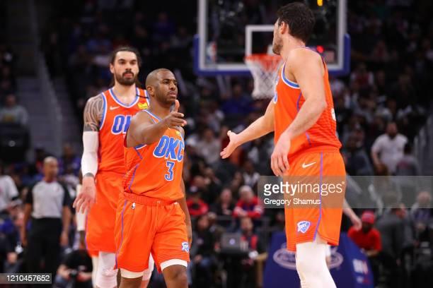 Chris Paul and Danilo Gallinari of the Oklahoma City Thunder celebrates Gallinari's fourth quarter three point basket against the Detroit Pistons at...
