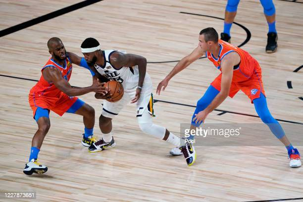 Chris Paul and Danilo Gallinari of the Oklahoma City Thunder guard Royce O'Neale of the Utah Jazz during the first half of an NBA basketball game on...
