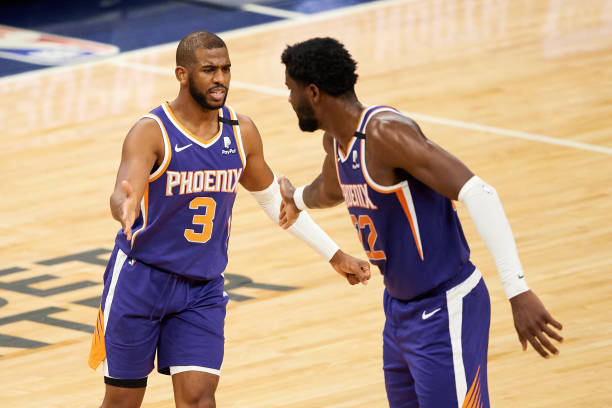 Chris Paul and Deandre Ayton of the Phoenix Suns celebrate a foul by the Minnesota Timberwolves during the fourth quarter of the game at Target...