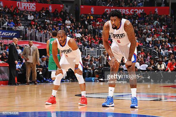 Chris Paul and DeAndre Jordan of the Los Angeles Clippers during the game against the Dallas Mavericks on April 10 2016 at STAPLES Center in Los...