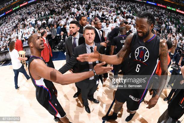 Chris Paul and DeAndre Jordan of the Los Angeles Clippers high five each other during the game against the Utah Jazz during the Western Conference...