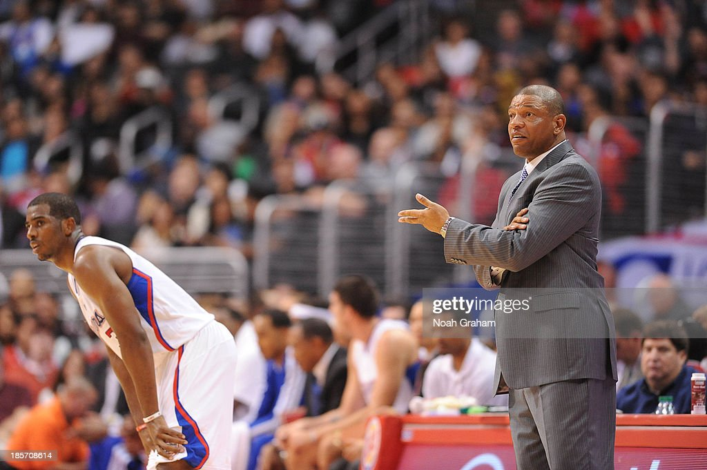 Chris Paul #3 and Doc Rivers of the Los Angeles Clippers look on against the Utah Jazz at Staples Center on October 23, 2013 in Los Angeles, California.