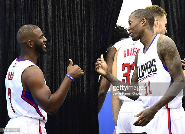 Chris Paul and Jamal Crawford of the Los Angeles Clippers exchange spots on the podium for interviews during media day at the Los Angeles Clippers...