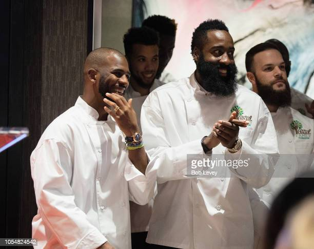 Chris Paul and James Harden of the Houston Rockets prepares to serve guests at the Chris Paul Family Foundation's Celebrity Server Fundraiser at...