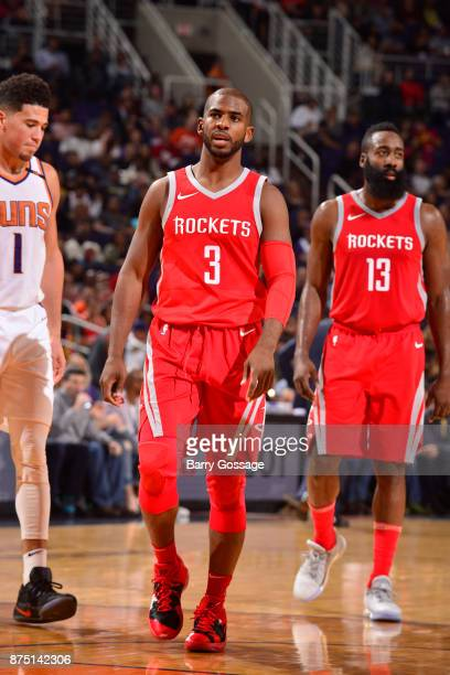 Chris Paul and James Harden of the Houston Rockets react to a play against the Phoenix Suns on November 16 2017 at Talking Stick Resort Arena in...