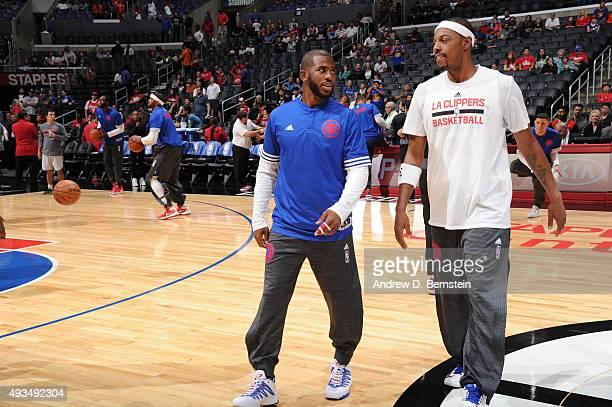 Chris Paul and Josh Smith of the Los Angeles Clippers warms up before the game against the Golden State Warriors on October 20 2015 at STAPLES Center...