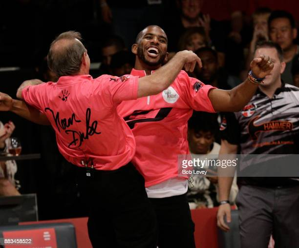 Chris Paul and Norm Duke chest bump attends the State Farm Chris Paul PBA Celebrity Invitational at the Bowlero Woodlands on November 30 2017 in The...