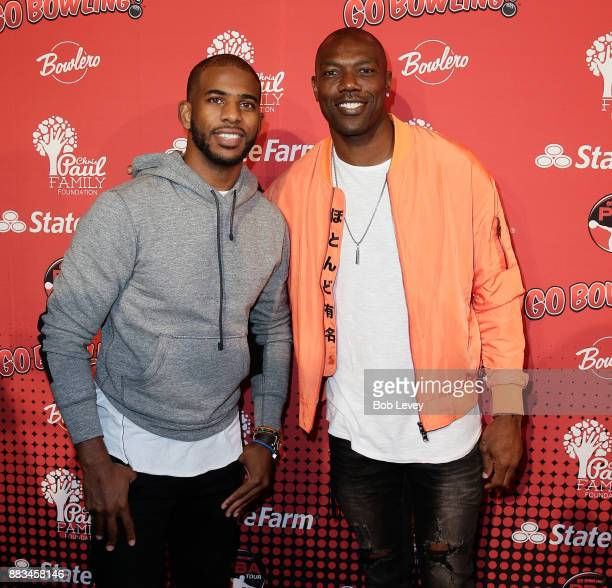 Chris Paul and Terrell Owens attend the State Farm Chris Paul PBA Celebrity Invitational at the Bowlero Woodlands on November 30 2017 in The...