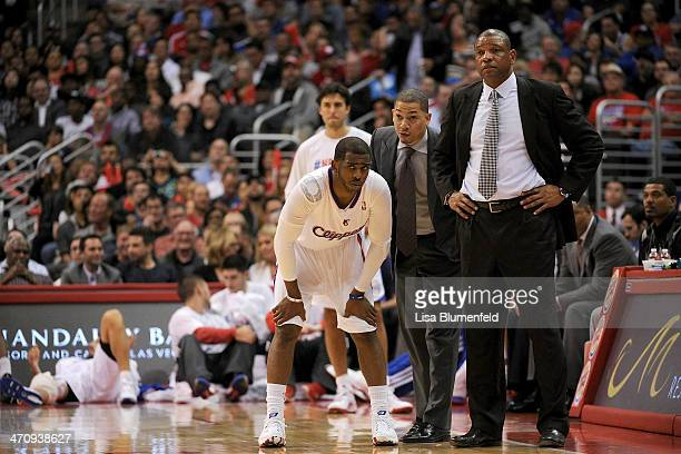 Chris Paul assistant coach Tyronn Lue and head coach Doc Rivers of the Los Angeles Clippers look on during the game against the Portland Trail...