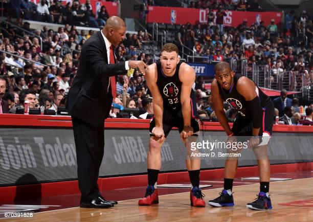 Chris Paul Blake Griffin and Head Coach Doc Rivers of the LA Clippers stand on the court during a game against the Cleveland Cavaliers on March 18...