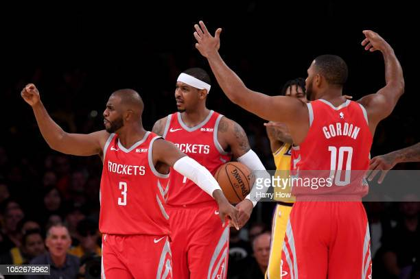 Chris Paul Carmelo Anthony and Eric Gordon of the Houston Rockets call for a continuation basket on a shot by James Harden after a foul by Brandon...