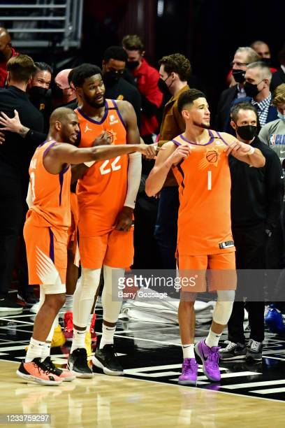 Chris Paul Deandre Ayton and Devin Booker of the Phoenix Suns look on after the game against the LA Clippers during Game 6 of the Western Conference...