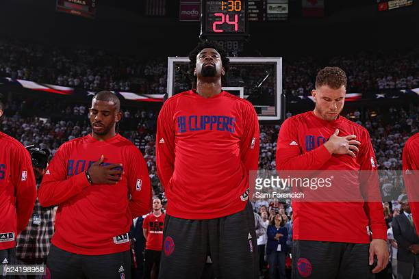 Chris Paul DeAndre Jordan and Blake Griffin of the Los Angeles Clippers stands for the national anthem prior to the game against the Portland Trail...