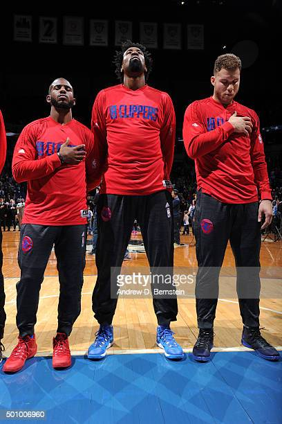 Chris Paul DeAndre Jordan and Blake Griffin of the Los Angeles Clippers stand for the national anthem before the game against the Minnesota...