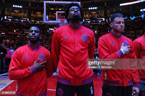 Chris Paul DeAndre Jordan and Blake Griffin of the Los Angeles Clippers stand for the national anthem before the game against the Washington Wizards...