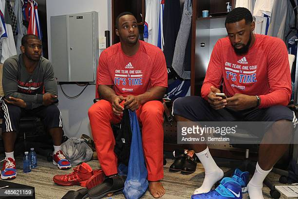 Chris Paul Glen Davis and DeAndre Jordan of the Los Angeles Clippers sit in the locker room before Game One of the Western Conference Quarterfinals...
