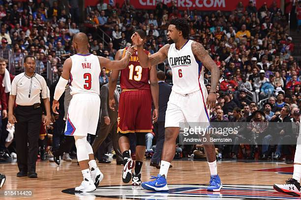 Chris Paul high fives teammate DeAndre Jordan of the Los Angeles Clippers during the game against the Cleveland Cavaliers on March 13 2016 at STAPLES...
