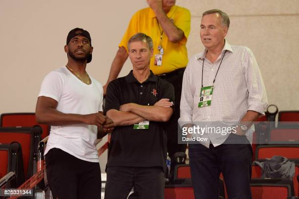 Chris Paul Jeff Bzdelik and Mike D'Antoni of the Houston Rockets are seen at the game between the Houston Rockets and the Cleveland Cavaliers during...
