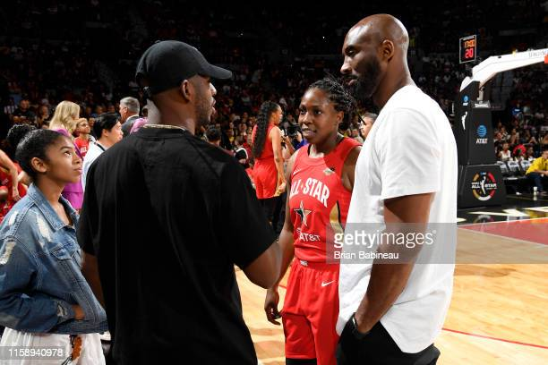 Chris Paul of Oklahoma City Thunder speaks with Chelsea Gray and retired NBA player, Kobe Bryant during the AT&T WNBA All-Star Game 2019 on July 27,...