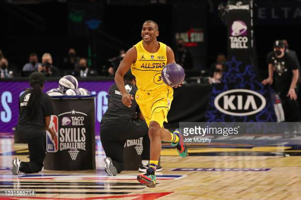 Chris Paul of Team LeBron smiles during the Taco Bell Skills Challenge as part of 2021 NBA All Star Weekend on March 7, 2021 at State Farm Arena in...