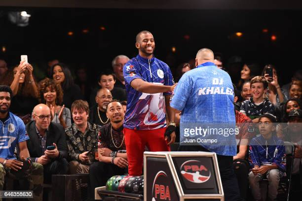 Chris Paul of the LA Clippers and Rapper DJ Khaled shake hands at the State Farm CP3 PBA Celebrity Invitational hosted by Los Angeles Clippers...