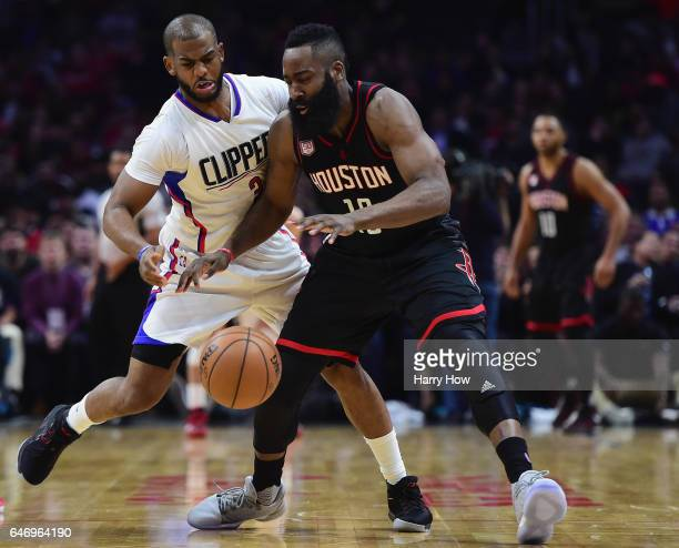 Chris Paul of the LA Clippers guards James Harden of the Houston Rockets during a 122103 Rockets win at Staples Center on March 1 2017 in Los Angeles...