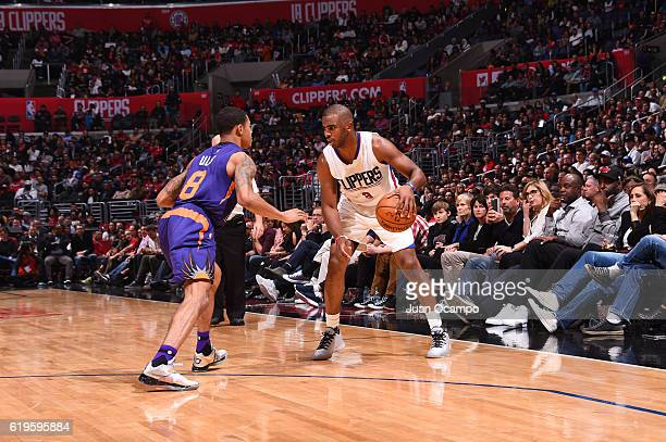 Chris Paul of the LA Clippers handles the ball against Tyler Ulis of the Phoenix Suns during a game on October 31 2016 at the STAPLES Center in Los...