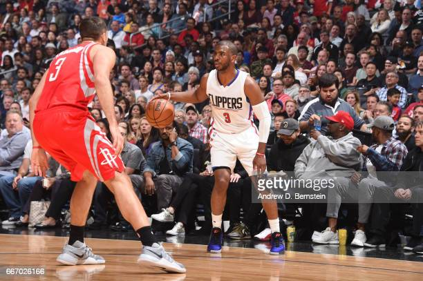 Chris Paul of the LA Clippers handles the ball during a game against the Houston Rockets on April 10 2017 at STAPLES Center in Los Angeles California...
