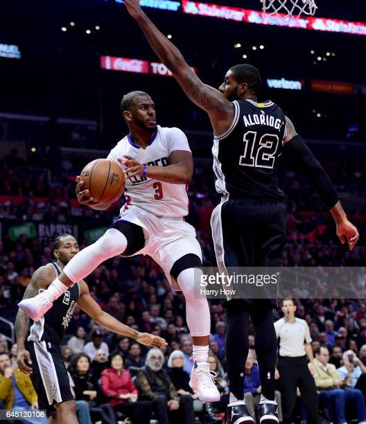 Chris Paul of the LA Clippers makes a pass around LaMarcus Aldridge of the San Antonio Spurs during the first half at Staples Center on February 24...