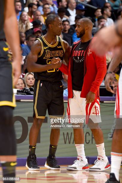 Chris Paul of the Houston Rockets and Andre Ingram of the Los Angeles Lakers high five during the game on April 10 2017 at STAPLES Center in Los...