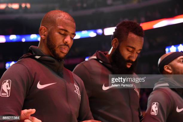 Chris Paul of the Houston Rockets and James Harden of the Houston Rockets during the national anthem before the game against the Los Angeles Lakers...