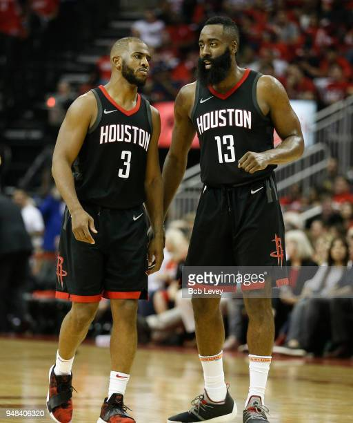 Chris Paul of the Houston Rockets and James Harden talk after comeing out of time out against the Minnesota Timberwolves during Game Two of the first...