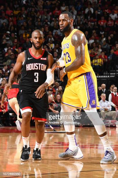 Chris Paul of the Houston Rockets and LeBron James of the Los Angeles Lakers fight for position on December 13 2018 at the Toyota Center in Houston...