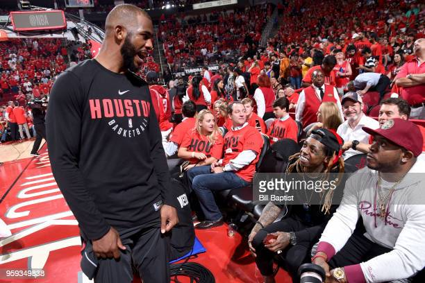 Chris Paul of the Houston Rockets and Lil Wayne talks after the game against the Golden State Warriors in Game Two of the Western Conference Finals...