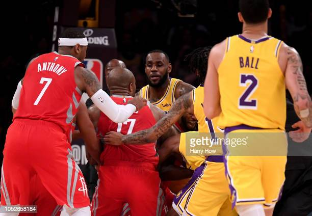 Chris Paul of the Houston Rockets and Rajon Rondo of the Los Angeles Lakers fight during a 124115 Rockets win at Staples Center on October 20 2018 in...