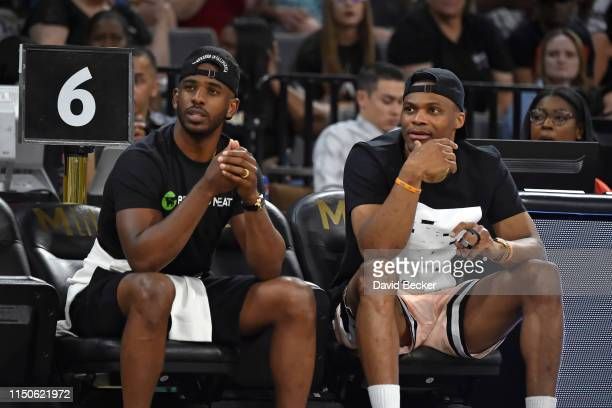 Chris Paul of the Houston Rockets and Russell Westbrook of the Oklahoma City Thunder attend the game between the New York Liberty and Las Vegas Aces...