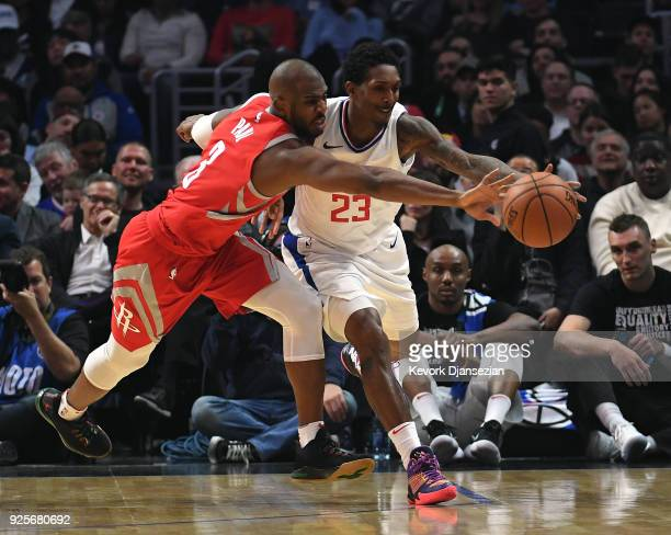 Chris Paul of the Houston Rockets attempts to steal the ball from Lou Williams of the Los Angeles Clippers during the first half at Staples Center on...