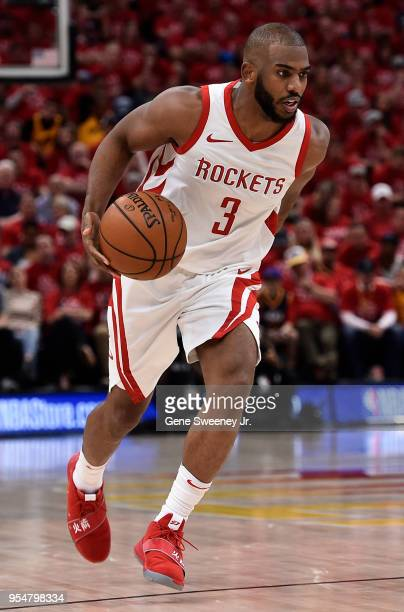 Chris Paul of the Houston Rockets brings the ball up court in the second half during Game Three of Round Two of the 2018 NBA Playoffs against the...