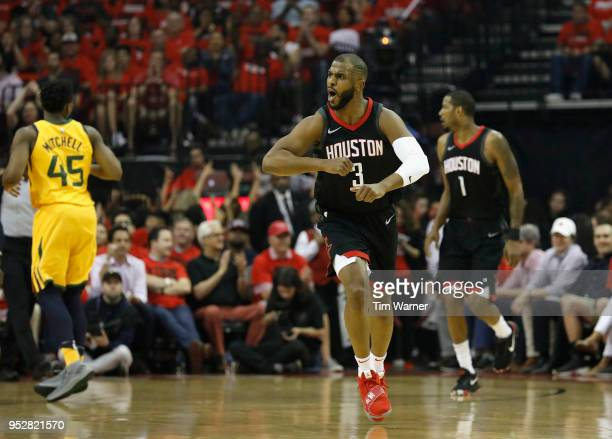 Chris Paul of the Houston Rockets celebrates after a three point shot in the first half during Game One of the Western Conference Semifinals of the...