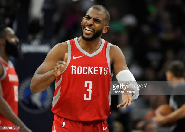 Chris Paul of the Houston Rockets celebrates during the third quarter of Game Four of Round One of the 2018 NBA Playoffs against the Minnesota...