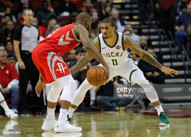 Chris Paul of the Houston Rockets controls the ball defended by Gary Payton II of the Milwaukee Bucks in the second half at Toyota Center on December...
